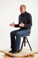 Sitting pose blue deep shirt jeans of Ed 0016