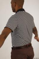 Upper black white striped shirt brown jeans of Arturo 0005