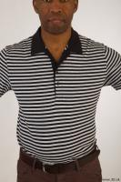 Upper black white striped shirt brown jeans of Arturo 0001