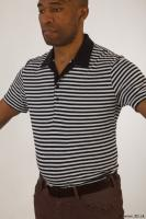 Upper black white striped shirt brown jeans of Arturo 0002