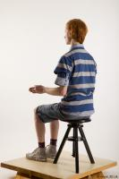Sitting reference of whole body striped blue gray shirt blue jeans shorts black gray shoes Wesley 0010