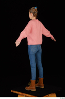 Shenika blue jeans brown shoes workers pink sweater standing whole body 0012.jpg