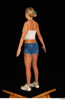 Victoria Pure blue jeans shorts pink top standing whole body 0006.jpg