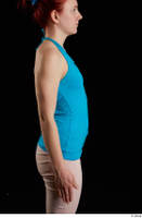 Vanessa Shelby  1 arm blue tank top flexing side view 0001.jpg