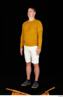 Paul Mc Caul blue shoes casual dressed standing white shorts whole body yellow sweatshirt 0002.jpg