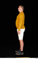 Paul Mc Caul blue shoes casual dressed standing white shorts whole body yellow sweatshirt 0003.jpg