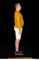 Paul Mc Caul blue shoes casual dressed standing white shorts whole body yellow sweatshirt 0007.jpg