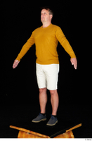 Paul Mc Caul blue shoes casual dressed standing white shorts whole body yellow sweatshirt 0010.jpg