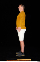 Paul Mc Caul blue shoes casual dressed standing white shorts whole body yellow sweatshirt 0011.jpg