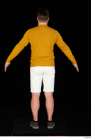 Paul Mc Caul blue shoes casual dressed standing white shorts whole body yellow sweatshirt 0013.jpg