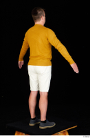 Paul Mc Caul blue shoes casual dressed standing white shorts whole body yellow sweatshirt 0014.jpg