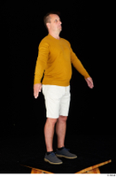 Paul Mc Caul blue shoes casual dressed standing white shorts whole body yellow sweatshirt 0016.jpg