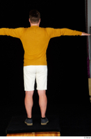 Paul Mc Caul blue shoes casual dressed standing white shorts whole body yellow sweatshirt 0021.jpg