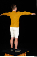 Paul Mc Caul blue shoes casual dressed standing white shorts whole body yellow sweatshirt 0022.jpg