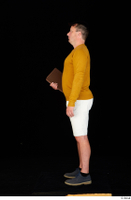 Paul Mc Caul blue shoes casual dressed standing white shorts whole body yellow sweatshirt 0027.jpg