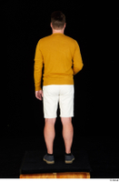 Paul Mc Caul blue shoes casual dressed standing white shorts whole body yellow sweatshirt 0029.jpg