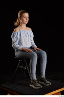 Sarah  1 black sneakers blue blouse blue jeans dressed sitting whole body 0006.jpg