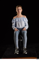 Sarah  1 black sneakers blue blouse blue jeans dressed sitting whole body 0007.jpg
