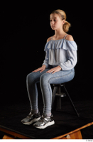 Sarah  1 black sneakers blue blouse blue jeans dressed sitting whole body 0008.jpg