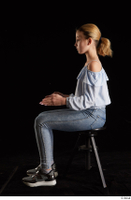Sarah  1 black sneakers blue blouse blue jeans dressed sitting whole body 0009.jpg