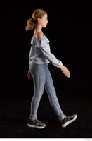 Sarah  1 black sneakers blue blouse blue jeans dressed side view walking whole body 0004.jpg