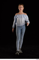 Sarah  1 black sneakers blue blouse blue jeans dressed front view walking whole body 0001.jpg