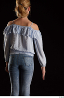 Sarah  1 arm back view blue blouse dressed flexing 0001.jpg
