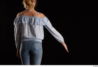 Sarah  1 arm back view blue blouse dressed flexing 0002.jpg