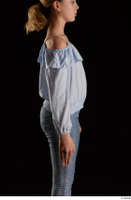 Sarah  1 arm blue blouse dressed flexing side view 0001.jpg