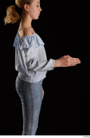 Sarah  1 arm blue blouse dressed flexing side view 0003.jpg